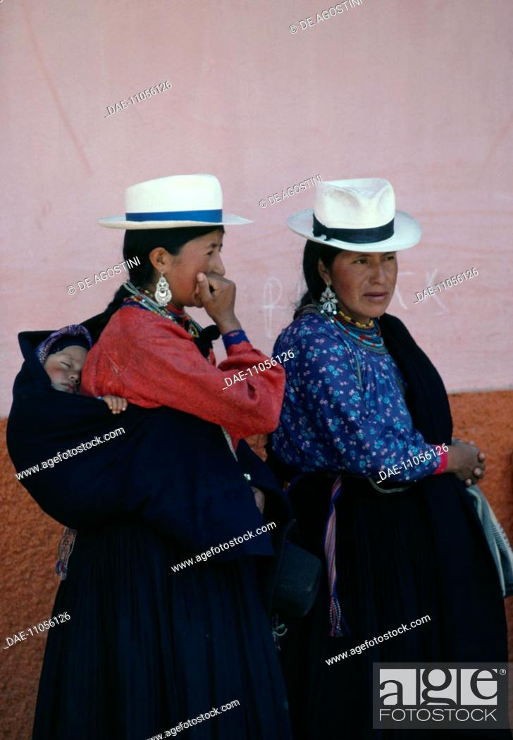 befe638c36a94 Stock Photo - Saraguro women wearing traditional clothing and panama hats,  Loja, Ecuador.
