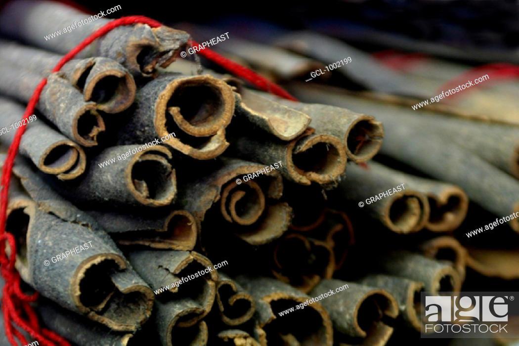Stock Photo: Cinnamon sticks for sale on a market in Dubai, United Arab Emirates.
