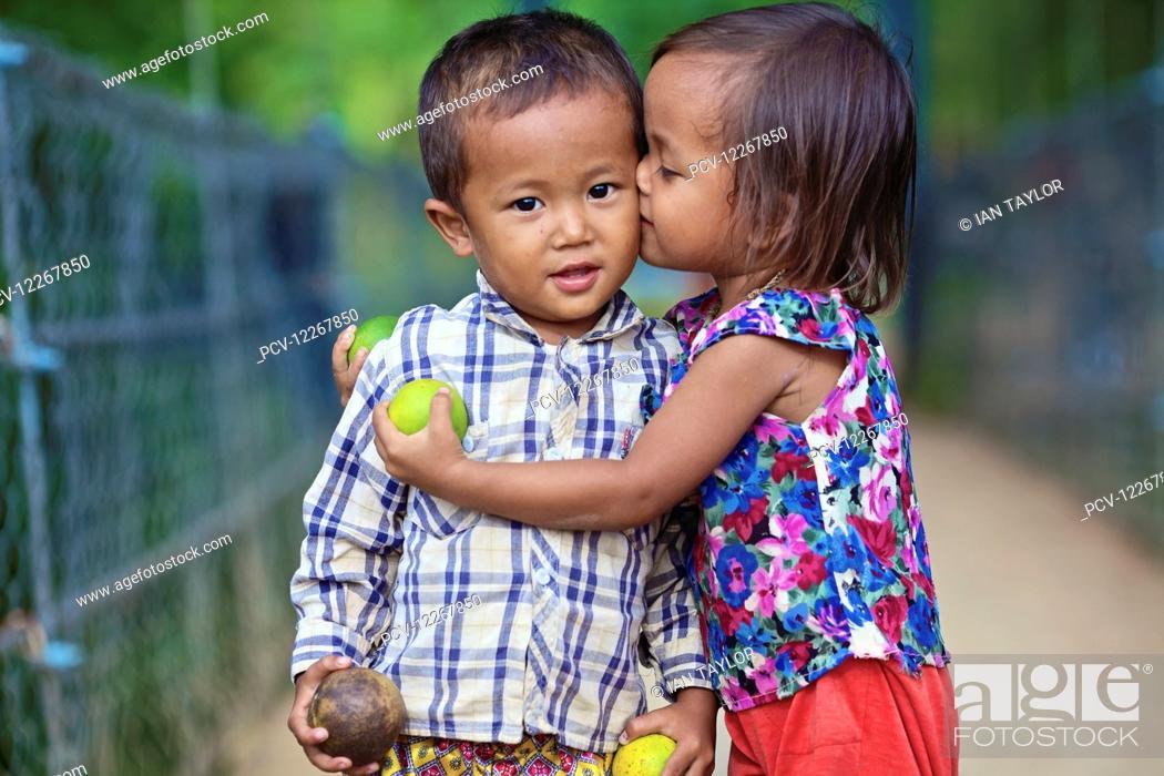 Young Girl Kissing A Young Boy Battambang Cambodia Stock Photo
