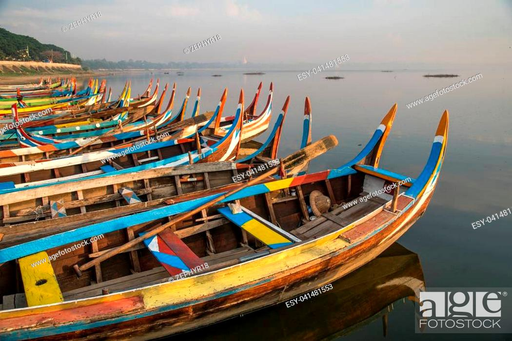 Stock Photo: group of traditional boat in Taungthaman Lake near the U Bein Bridge, famous landmark and tourist attraction of Amarapura Township, Mandalay, Myanmar (Burma).