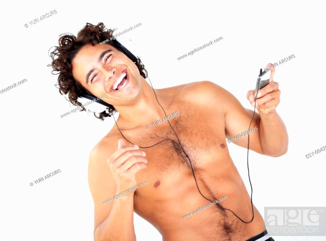 Stock Photo: Portrait of a handsome young shirtless man listening to his mp3 player.