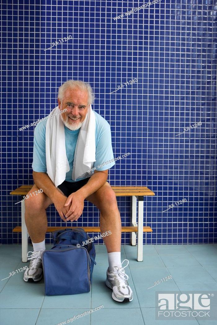 Stock Photo: Senior man in gym changing rooms, smiling, portrait.