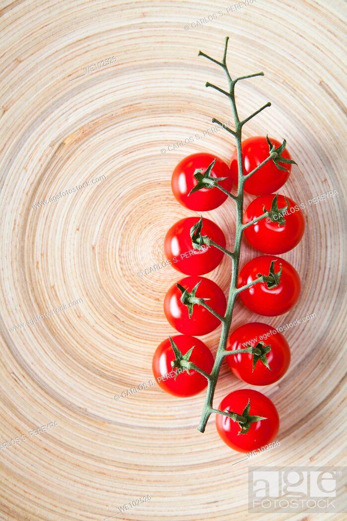 Stock Photo: a detail of tomato cherry.