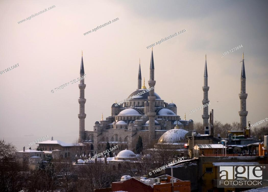 Stock Photo: Shy sunrise in winter on the snowy Sultan Ahmed Mosque Turkish: Sultanahmet Camii also called blue mosque, Istanbul, Turkey, with the fogy Bosphorus in the back.