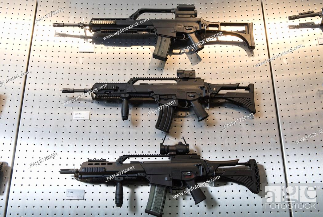 Different versions of the G36 assault rifle hanging on the