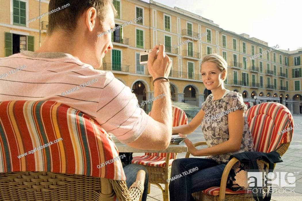 Stock Photo: Man and woman sitting at outdoor cafe.