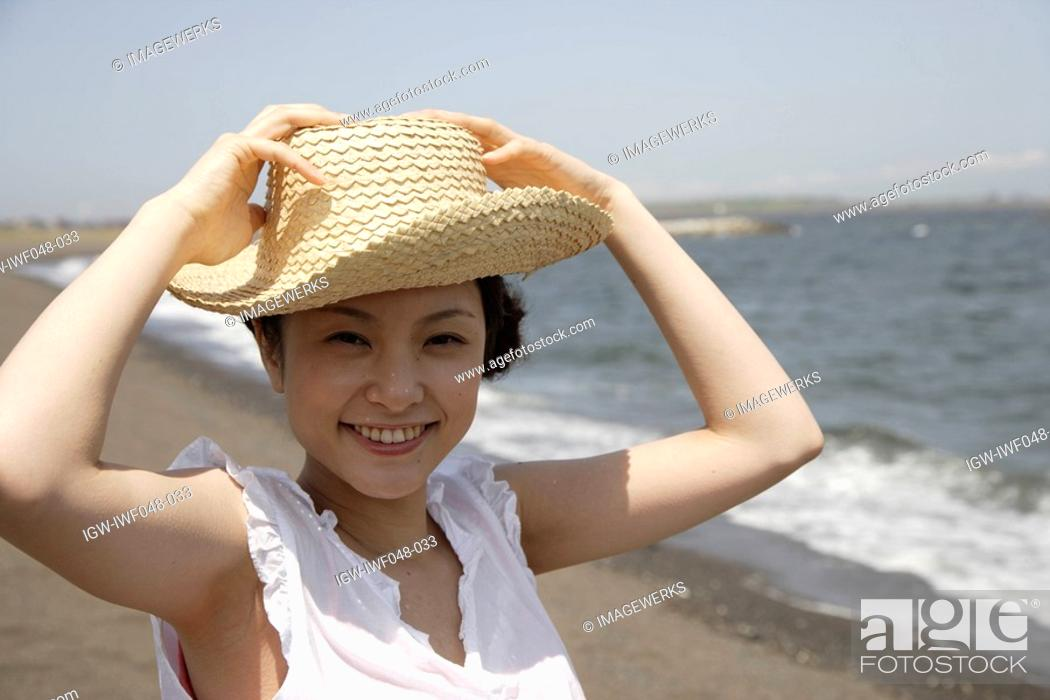 Stock Photo: Portrait of a young woman on beach.