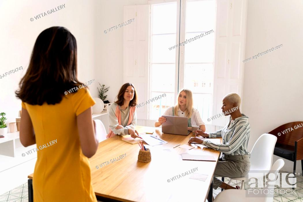 Stock Photo: Businesswoman leading a presentation in office.