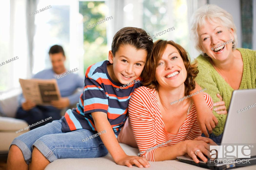 Stock Photo: Multi-generation family enjoying computer.