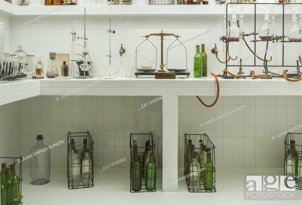 Stock Photo: Old vintage wine laboratory. Countertop full of instruments.