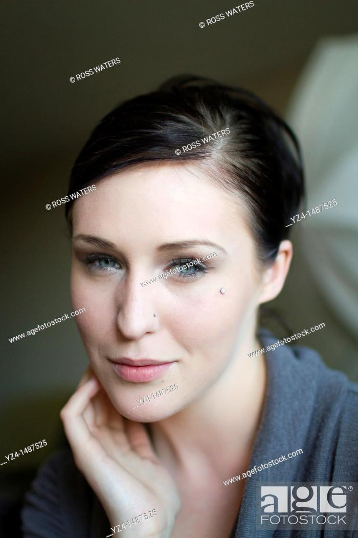 Stock Photo: Closeup of a young woman looking at the camera.
