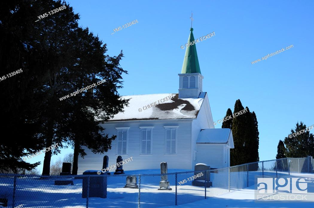 Stock Photo: Small Catholic Chapel and cemetery on Northern Illinois hillside.