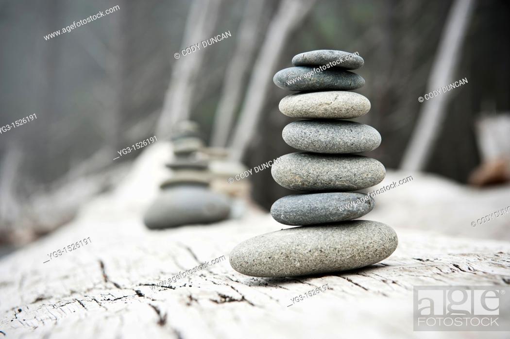 Stock Photo: Rock pile on driftwood, Rialto Beach, Olympic national park, Washington, USA.