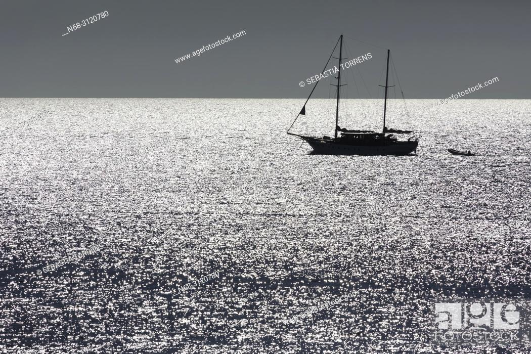 Stock Photo: Backlighting view of a yacht from Formentera, Balearic Islands, Spain.