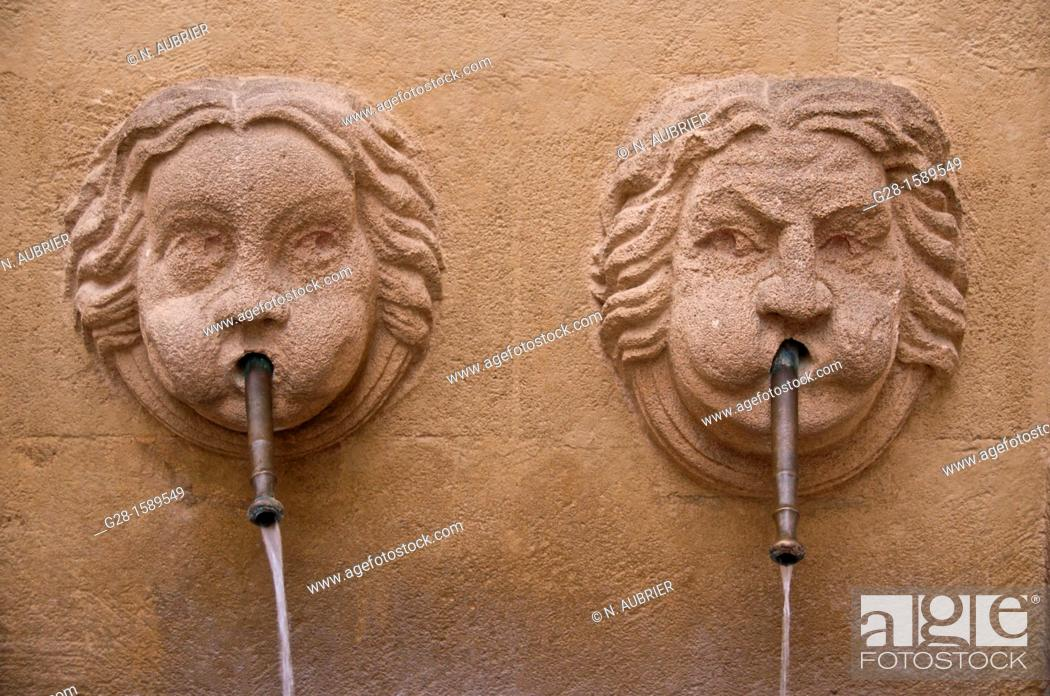 Stock Photo: Bagniers Fountain with two faces in old town, Aix en Provence, France.