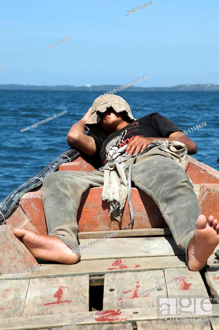 Stock Photo: Man sleeping in boat, Cambodia.