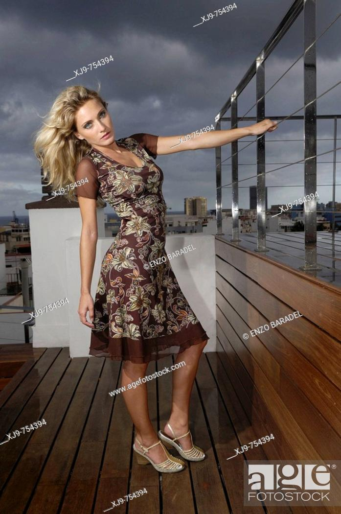 Stock Photo: Blond girl on the terrace.