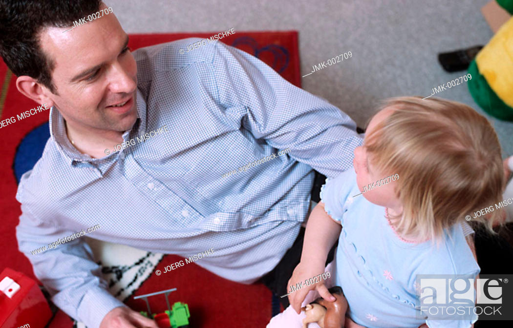 Stock Photo: A young father, man, 25-30 30-35 35-40 years old, playing with his little daughter, 1-5 years old, in the nursery.