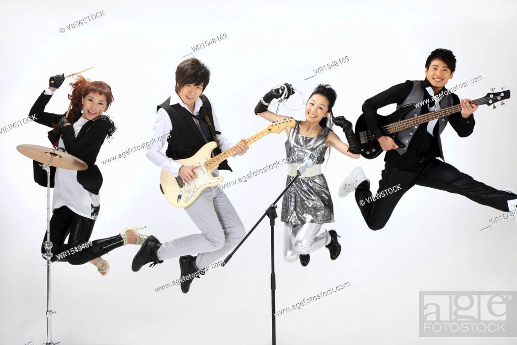 Stock Photo: studio shot of a musical band.