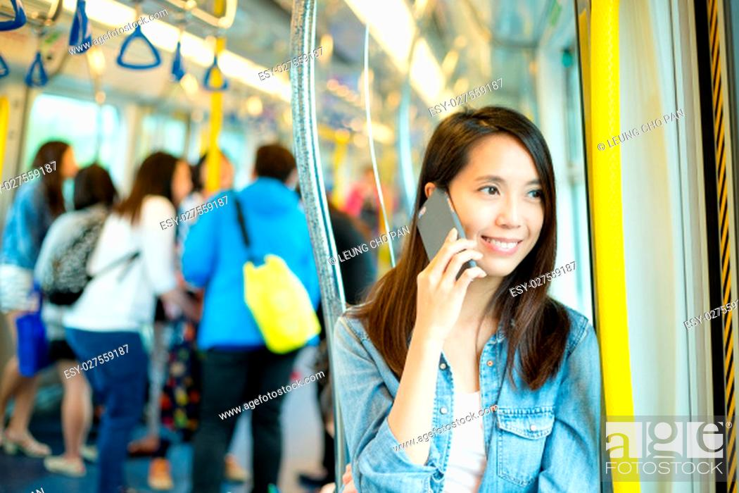 Stock Photo: Woman talk to cellphone in train compartment.