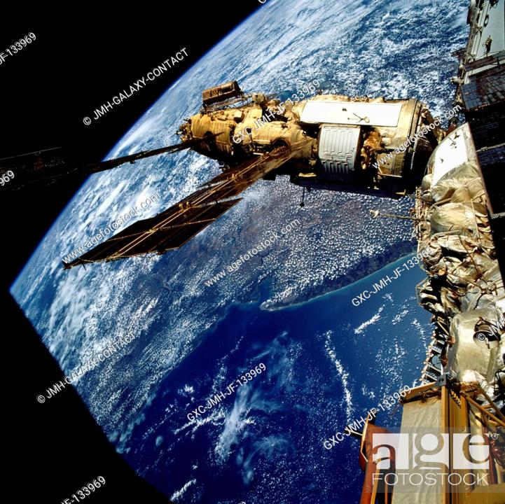 Stock Photo: The crew took this 70mm picture of Russia's Mir Space Station over Australia. The crew docked the Space Shuttle Atlantis with the Mir Space Station on March 23.