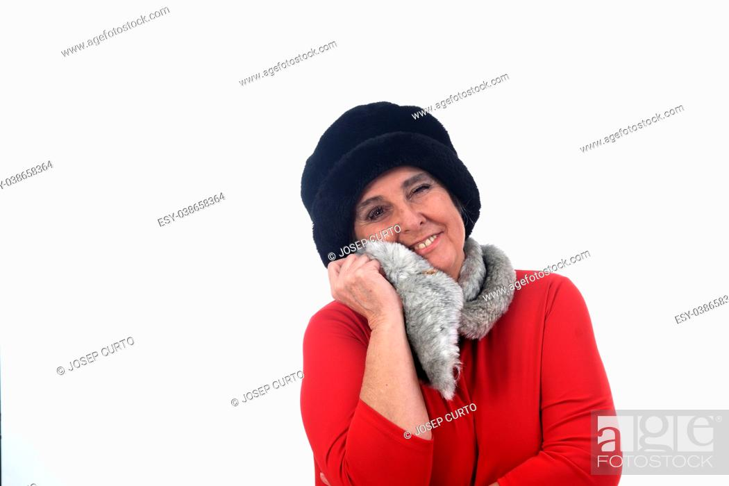 Stock Photo: portrait of a senior woman with hat.