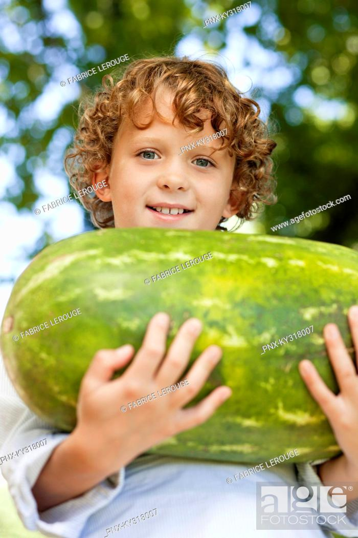 Stock Photo: Close-up of smiling boy holding watermelon.