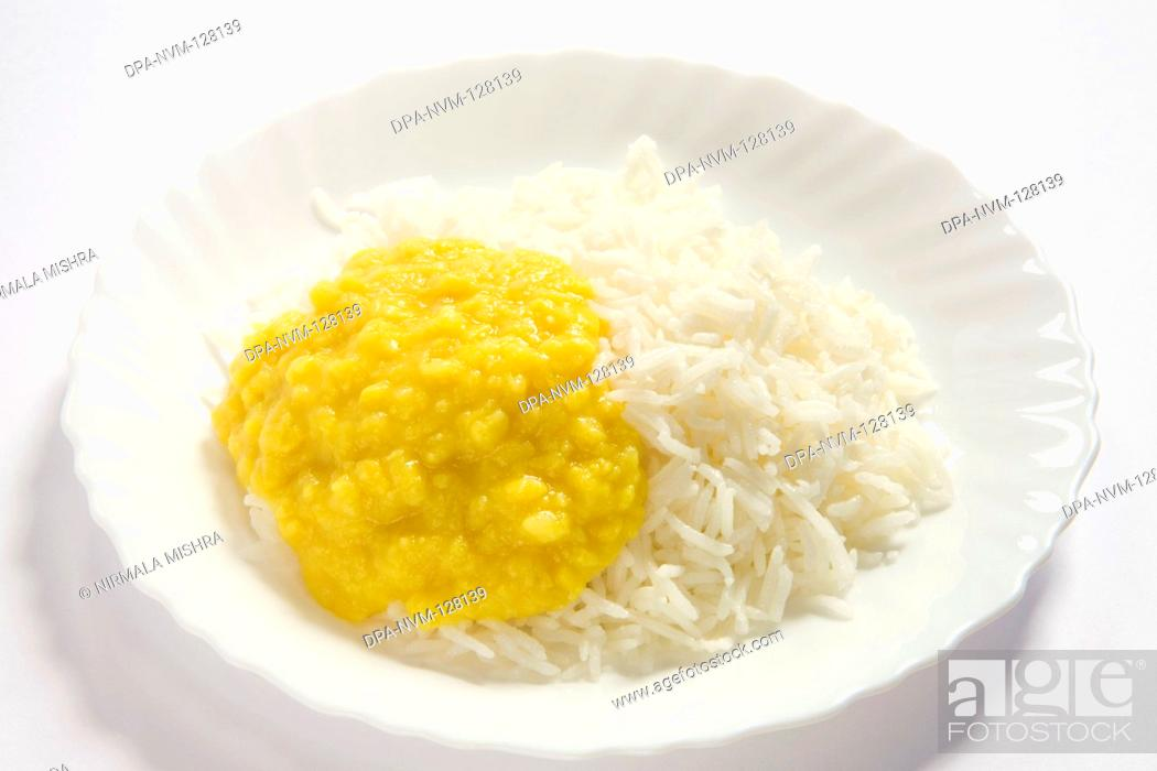 Stock Photo: Vegetarian , Indian cuisine dal bhath boil basmati rice bhath chaval oryza sativa and moong dal mung beans phaseolus aureus served in plate.