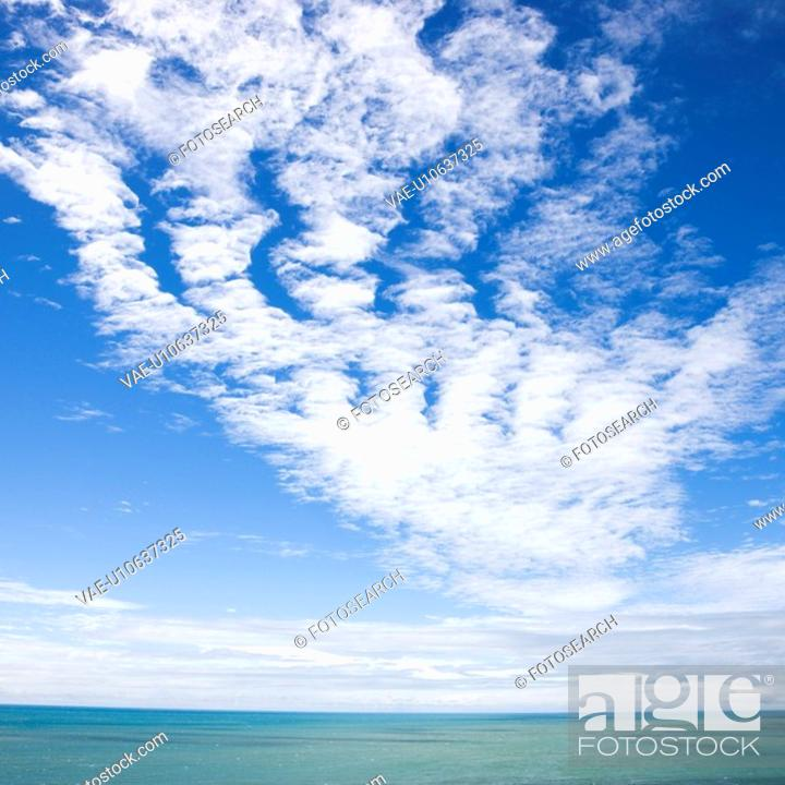 Stock Photo: Scenic view of horizon with blue sky and cloud texture over water.