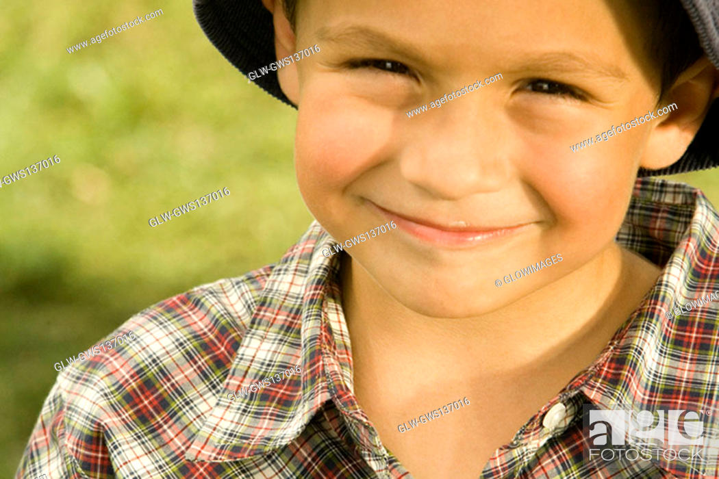 Stock Photo: Portrait of a boy holding a chocolate.