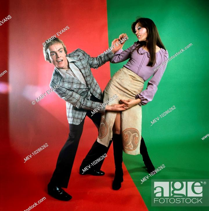 Stock Photo: Male, female, fashion models, Holding hands, couple, groovy, posing.