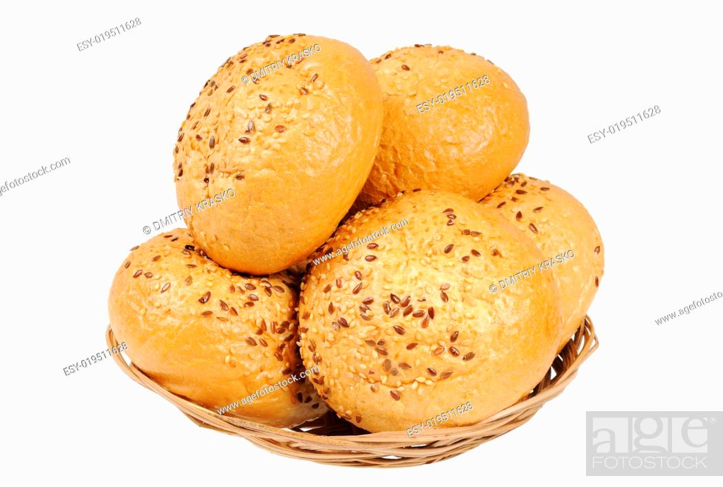 Stock Photo: Bun, topped with sesame seeds in a basket.