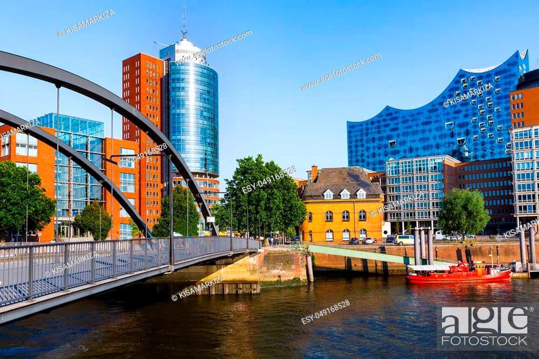 Stock Photo: City of Warehouses or Speicherstadt district, Niederbaumbridge bridge and Kehrwiederspitze in Hamburg city, Germany.