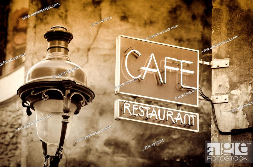Stock Photo: Cafe sign and lamp post, Paris, France.