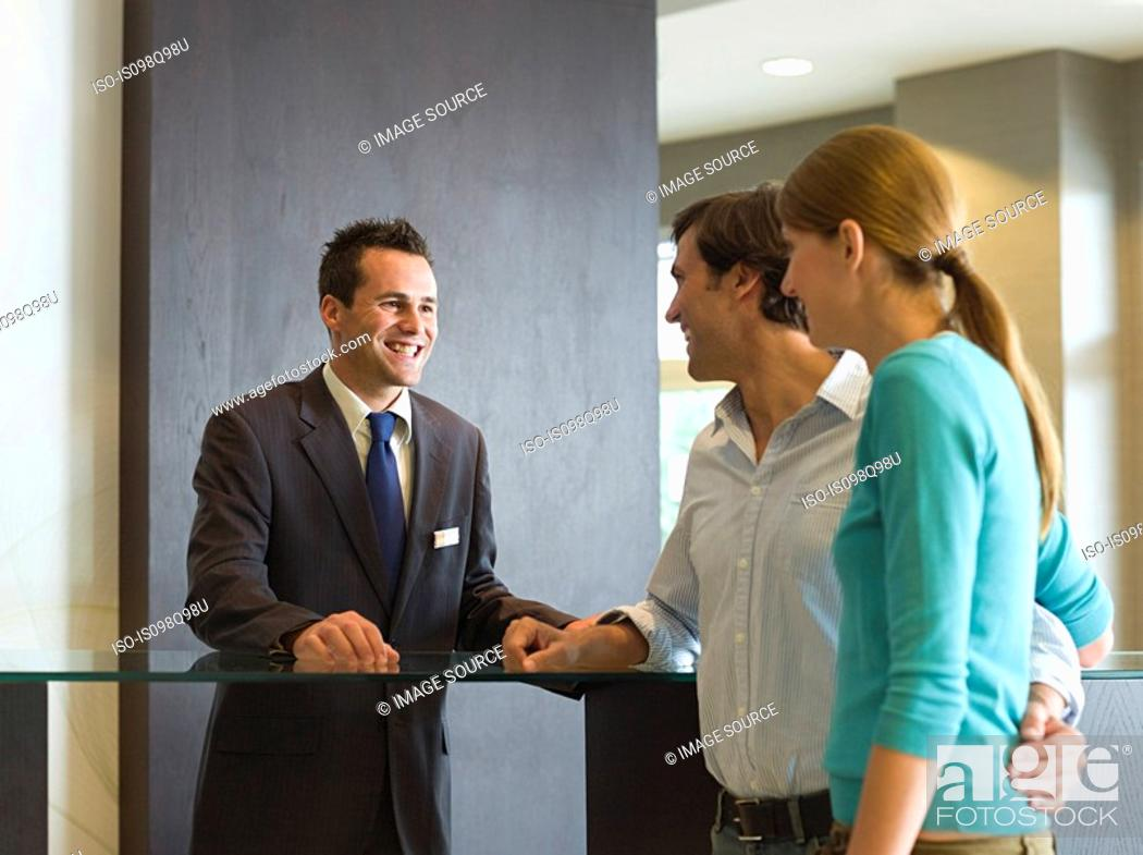 Stock Photo: Couple at a hotel reception.