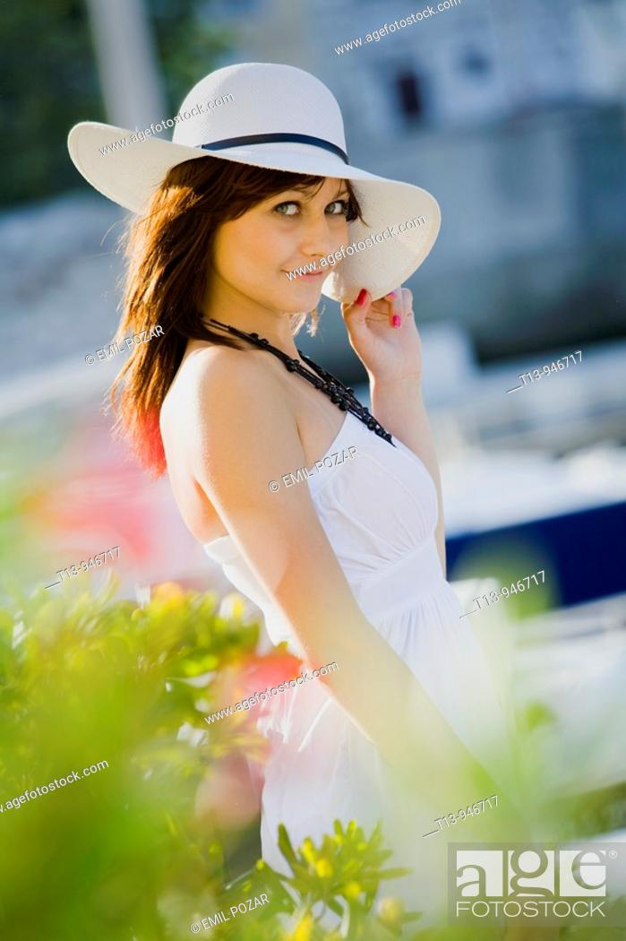Stock Photo: Young lady with White hat is fancying.