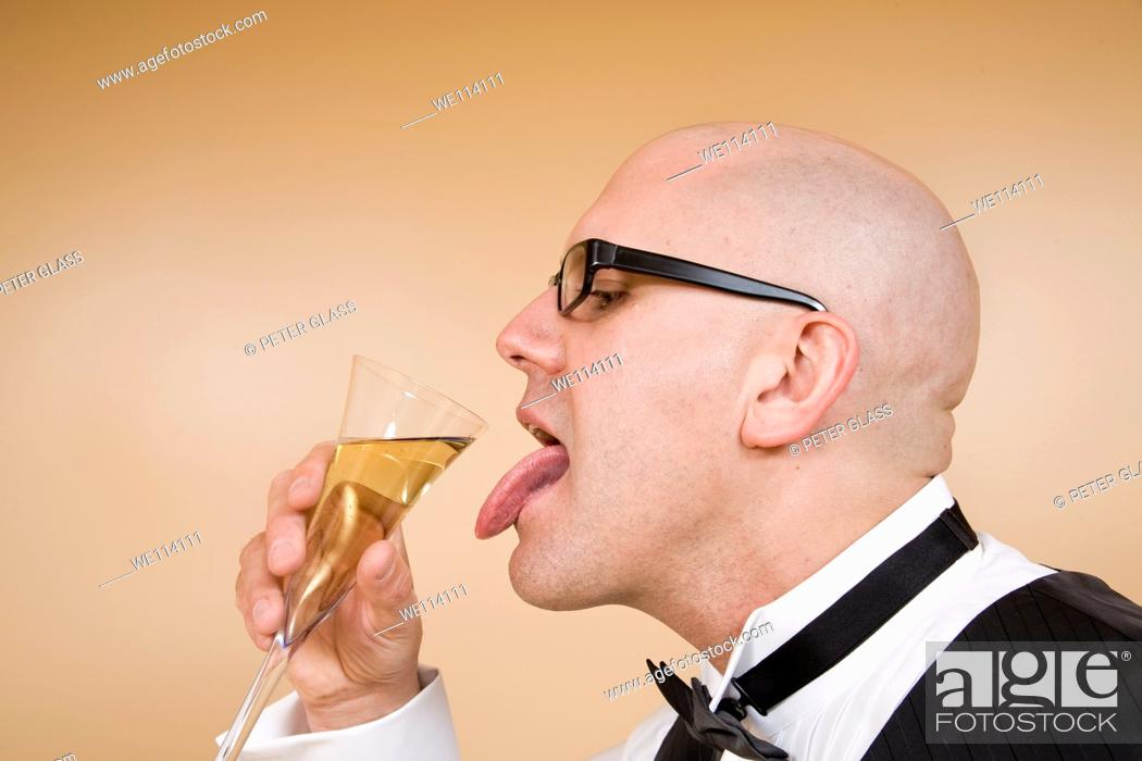 Stock Photo: Middle-age bald man with a glass of champagne.