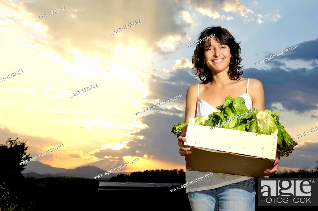 Stock Photo: girl with a box of lettuce.