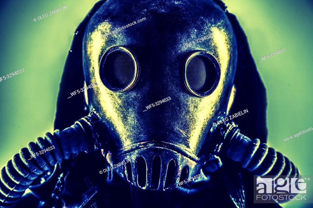 Stock Photo: Close up portrait of nuclear post-apocalypse survivor, living underground mutant or creature, skilled stalker wearing rags and armored full-face gas mask or air.
