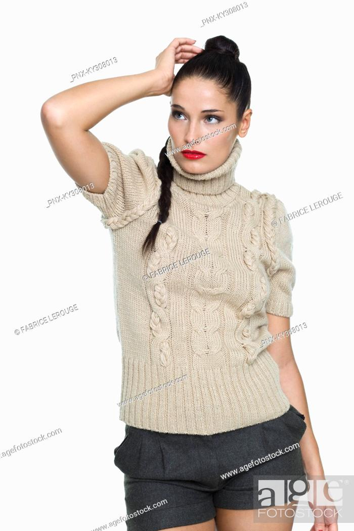 Stock Photo: Young woman with hand in hair.