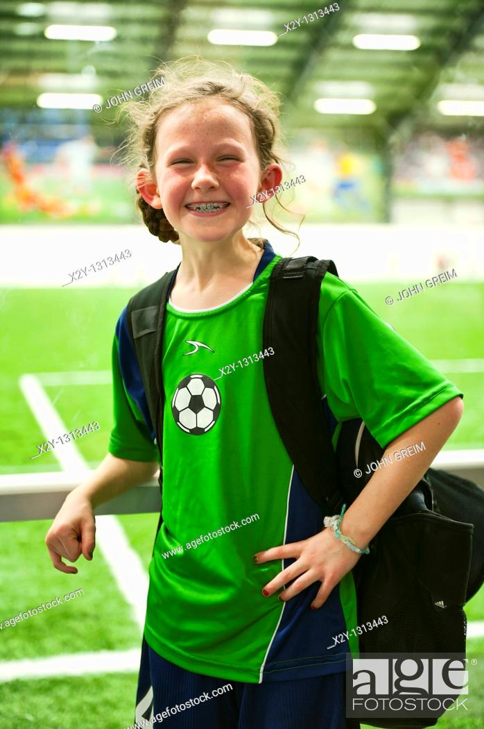 Stock Photo: Portrait of a smiling young soccer player.