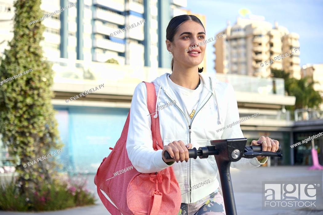 Stock Photo: Young woman doing sport outdoors in the city..