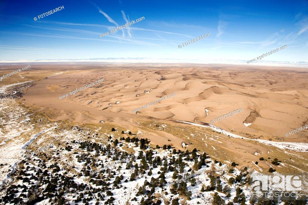 Stock Photo: Aerial landscape of snowy plains and dunes in Great Sand Dunes National Park, Colorado.
