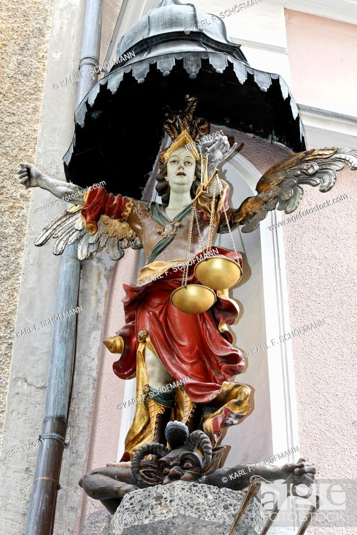 Stock Photo: Angel with golden scales in her hand standing on the head of a devil, baroque house statue, Judengasse lane, old town, Salzburg, Austria, Europe.