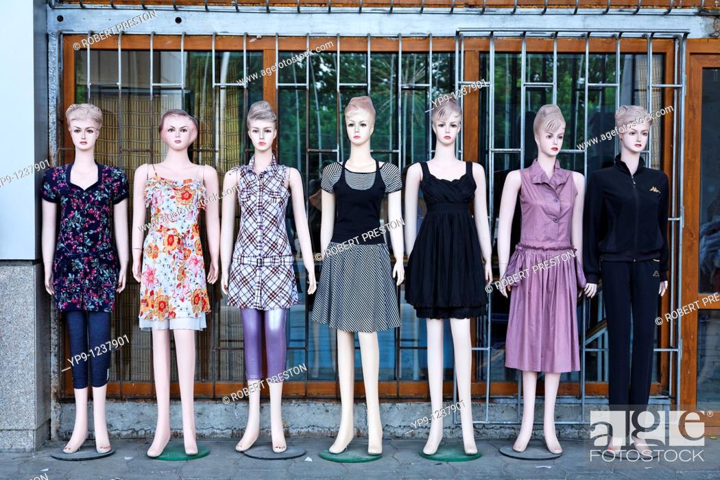 Stock Photo: Kyrgyzstan - Bishkek - Mannikins outside a clothes shop.