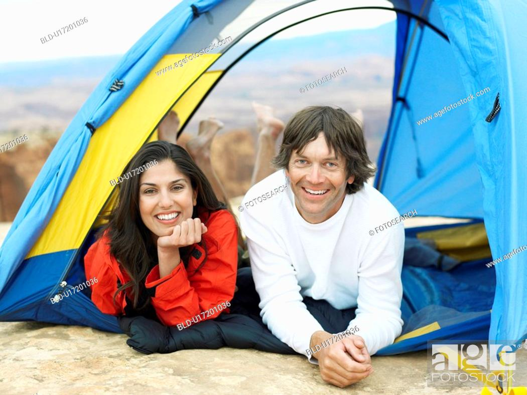 Stock Photo: Couple lying in tent, portrait.