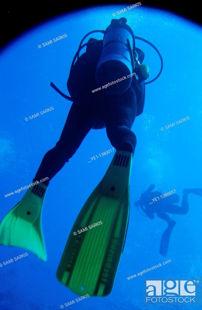 Stock Photo: Two scuba divers swimming around Cathedral Dive Spot, Pango Point, Efate Island, Vanuatu.