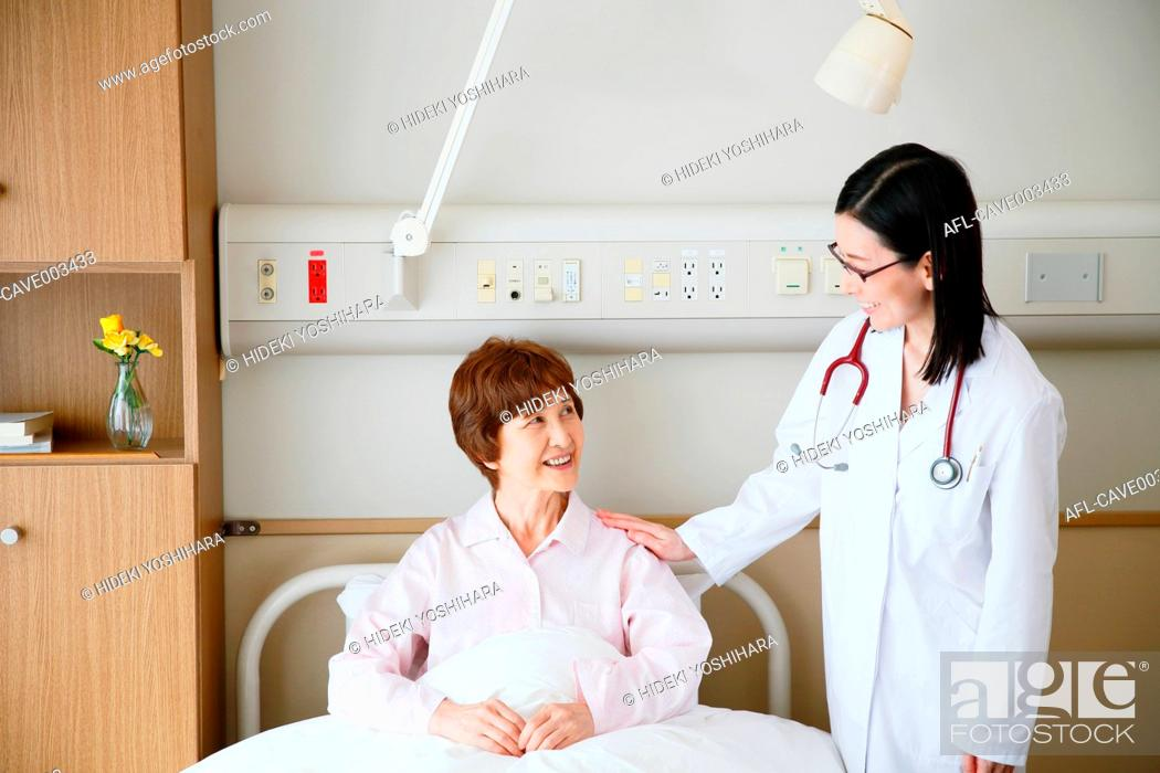 Stock Photo: Japanese doctor checking patient.