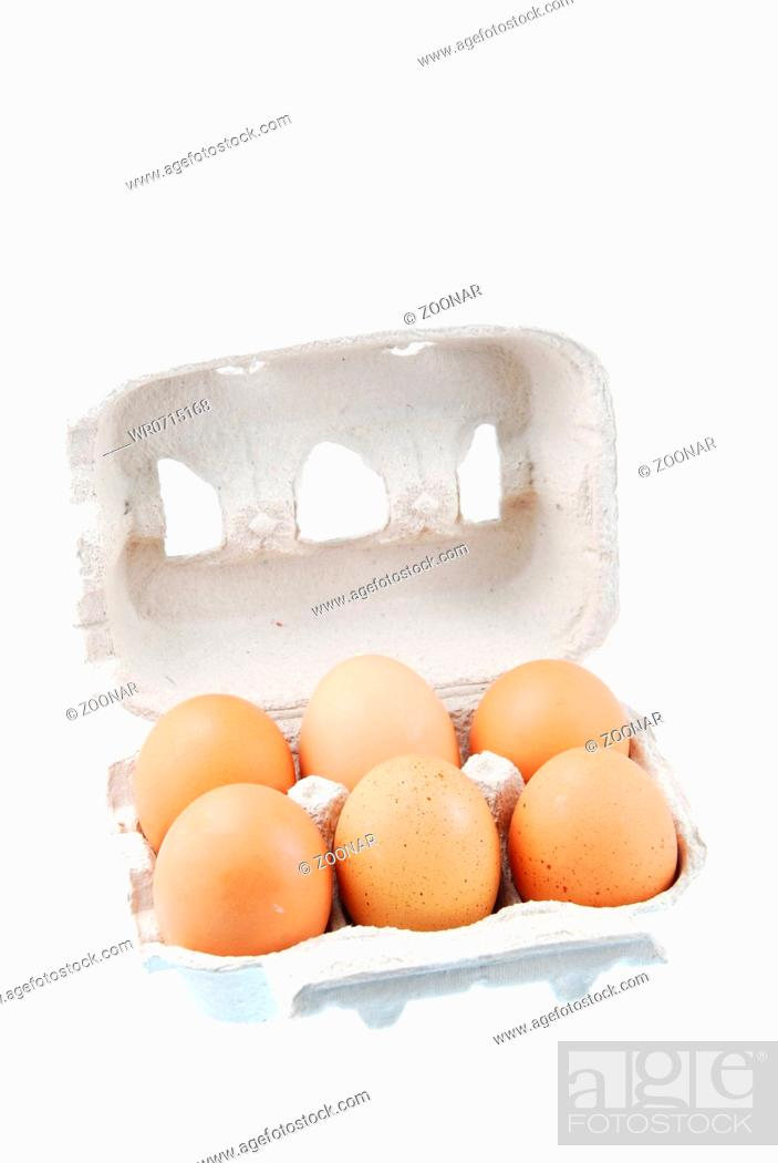 Stock Photo: half dozen fresh eggs in a recycled box isolated on white background.