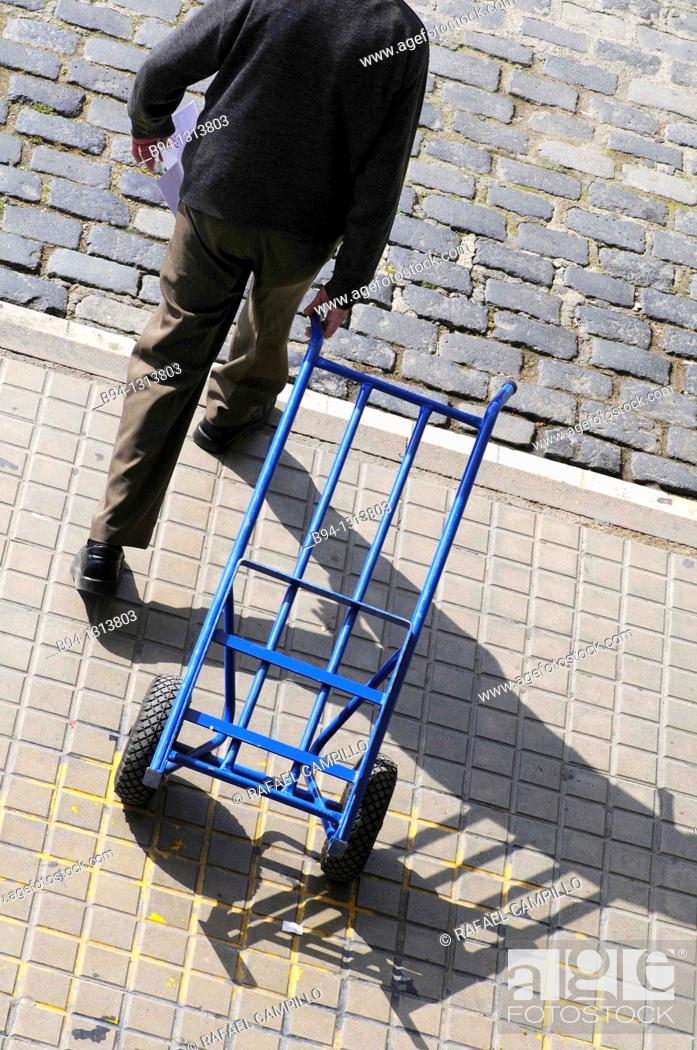 Stock Photo: Man with hand truck.